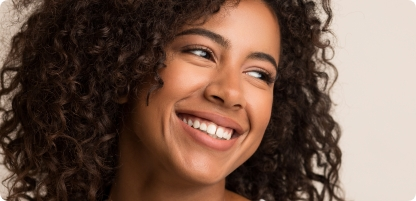 Young woman smiling after specialized periodontal therapy